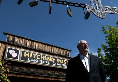 Minister Don Knapp stands in front of the Hitching Post Wedding Chapel. (Courtesy Kathy Plonka, Spokesman-Review)