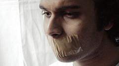 man with mouth taped